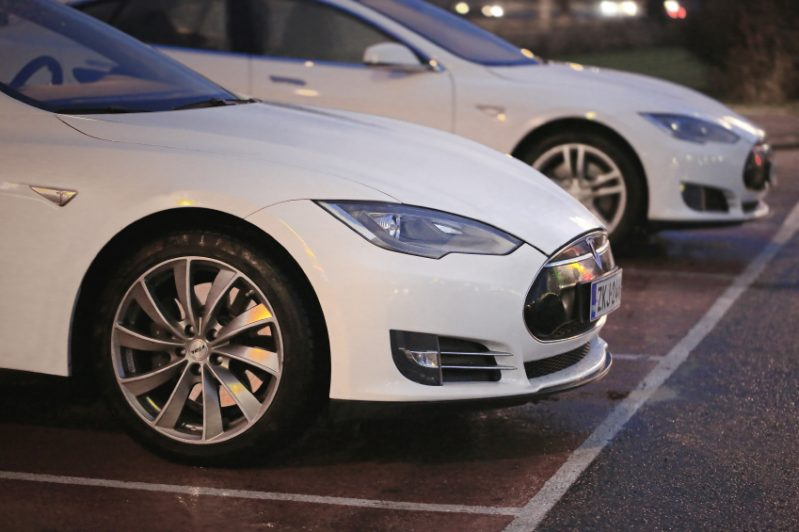 Two White Tesla Model S Cars at Night