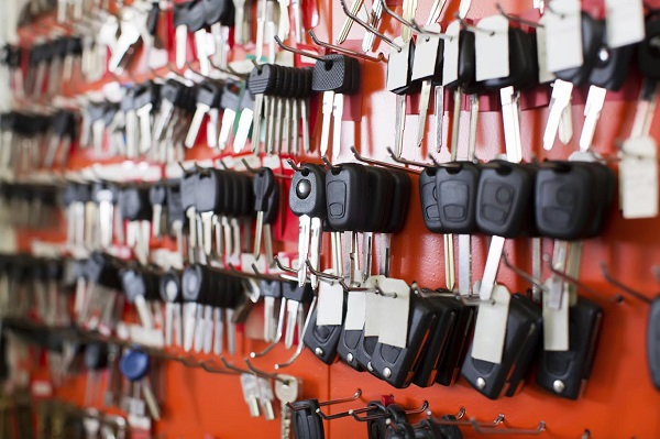 Locksmith stand with variety of car and van keys on hooks