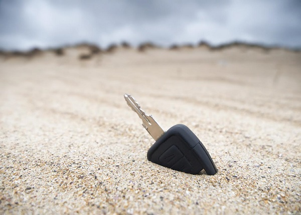 Car key lost in the sand on the beach