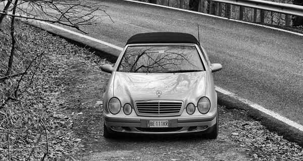 Borgio Verezzi, Italy - December 28, 2006: Mercedes Benz Car parker near a country road. Photo taken in a public area