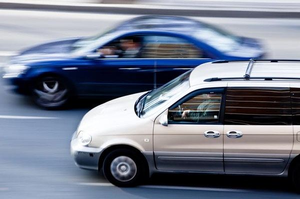 Two cars speeding along the road in Sevilla Spain. Motion blur.