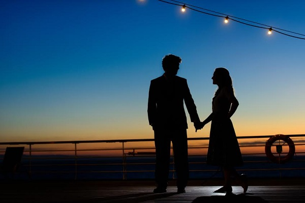 Silhouette of a couple enjoying the sunset.