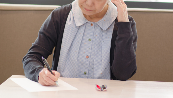 woman is writing a document